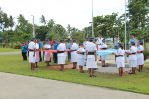 Police Officers readying to raise the flags of Samoa and the United Nations