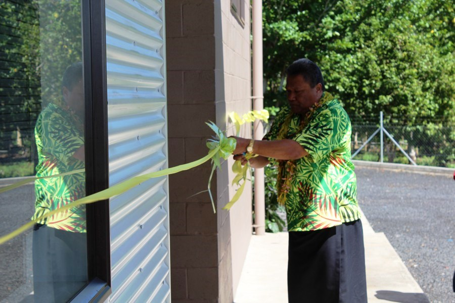 MWTI Minister Manualesagalala Enokati Posala cuts the ribbon to the new Fuluasou Substation building.