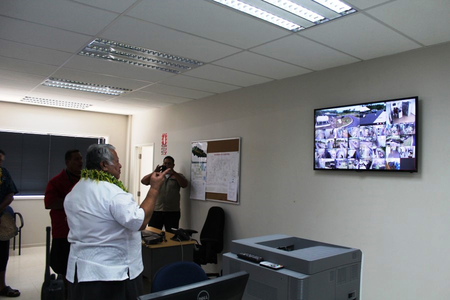 Prime Minister Tuilaepa surveys the monitoring screen where live feeds are shown from various EPC sites around the country.