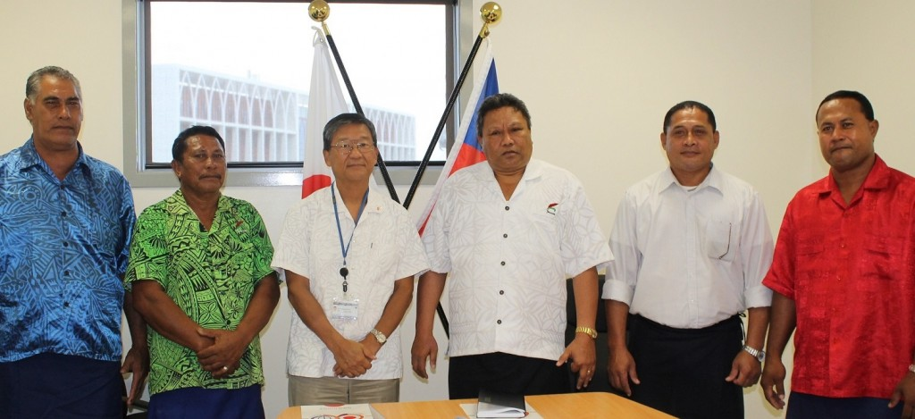 Japan's Ambassador to Samoa Tuimaugaoalii Kazumasa Shibuta, President of the Lotofaga Safata Primary School Committee Honorable Manualesagalala Enokati Posala (center) flanked by members of  the Lotofaga Safata Primary School Committee.
