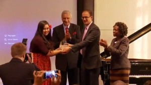 Brianna receives her award from the Commonwealth Secretariat