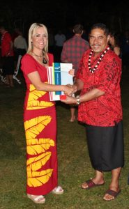 Minister Nikki Kaye hands over the NZ Building Code Standards to MWTI Associate Minister, Seiuli Ueligitone Seiuli